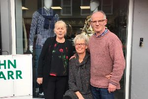 John, Afke and Dolores, pictured outside the new shop.
