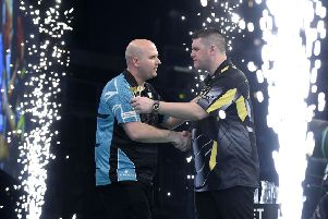 Rob Cross with Daryl Gurney during the Unibet Premier League Darts at the SSE Arena, Belfast