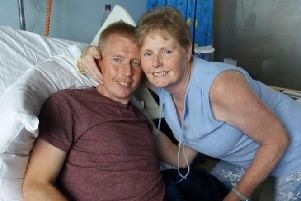 Dale Hutchison and his mother, Audrey, pictured in hospital a few days post-transplant.