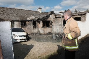 A woman in her 60s has been treated for shock after an arson attack in Derry last night