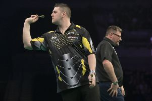 Daryl Gurney in action against James Wade.