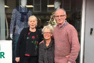 Afke Barr (centre) pictured outside the new John Barr Fashions in Buncrana with her husband John and Dolores McLaughlin, who works in the shop.
