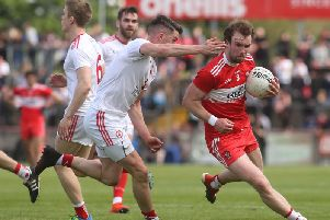 Derry midfielder Padraig Cassidy takes on Tyrone's Richard Donnelly during the Ulster Championship Preliminary Round clash at Healy Park.
