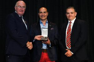 GAA President John Horan (left) presents Club Derry's Paul Lupari and Derry County PRO Conor Nicholl with the McNamee Award in Dublin on Saturday evening.