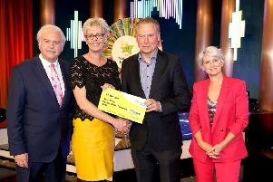 Afke Barr from Buncrana won 37,000 euro,  including a car on last Saturday's ( Winning Streak Game Show on RTE. Pictured here at the presentation of the winners cheques were from left to right: Marty Whelan, Winning Streak game show co-host; Afke Barr the winning recipient; Dermot Griffin, Chief Executive of the National Lottery and Sinead Kennedy, Winning Streak Game Show co-host. The winning ticket was bought from Bradley's Shop, Gort, Fahan.. Pic: Mac Innes Photography