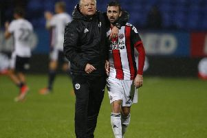 Danny Lafferty is embraced by Sheffield United manager, Chris Wilder.