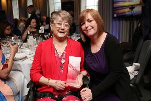 Joan McKee and Nichola Corner, receiving a posthumous award for Lyra McKee's commitment and contribution to journalism from the Journalists' Charity.