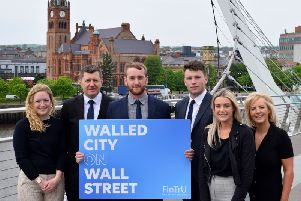 Pictured at the Peace Bridge in Derry are (2nd left) Greg McCann, FinTrU Executive Director & North West Office Site Head with previous FinTrU NW Assured Skills Academy graduates, now FinTrU Analysts (l-r) Jenny Thompson, Damian Faulkner, CJ Martin and Megan Quigley.