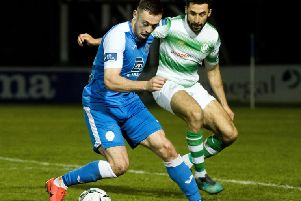 Finn Harps striker Nathan Boyle shields the ball from Shamrock Rovers defender Roberto Lopes. Picture by Evan Logan/INPHO