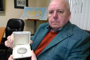 Robbie McCarter pictured with Dr Pereira's Papal medal from the Pope.
