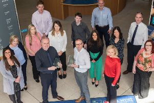 Conor McGurgan, Marketing and PR manager and Fergal Tuffy, Technology Innovation Manager, pictured with the Marketing and PR team and Business Support Centre team at North West Regional College, double award winners at the 2019 North West Business Awards. (Picture Martin McKeown).