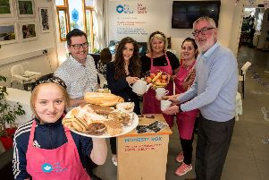 The Tea Room volunteer, Jamielee Mitchell bringa selection of pastries to the tables of the first Honesty Cafe in the Holywell Trust in Brishop's Street where she was joined by the Deputy Mayor, Councillor Cara Hunter, Gerard Deane, Holywell Trust, Lisa Clements, Holywell Trust, Eimear Doherty, volunteer and Jack O'Connor from the Department for Communities.  The cafe which serves breakfast lunch coffee and snacks operates on the principle that people can make a donation for their meal and if possibe a little extra to cover something for people who are less fortunate.Picture Martin McKeown. Inpresspics.com.