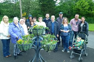 Housing Executive and Council staff put the finishing touches to the planters at Columbia Park, with JP McCloskey.