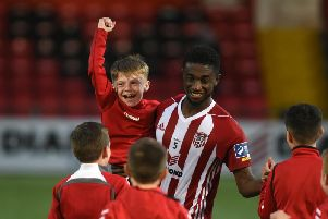 Junior Ogedi Uzokwe celebrates with a young fan at full time