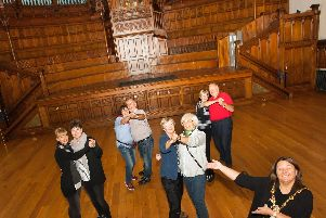 The Mayor of Derry City and Strabane District Council, Michaela Boyle pictured enlisting the help of some German tourists visiting the city to launch her new series of tea dances at the Main Hall, Guildhall on Wednesday morning.