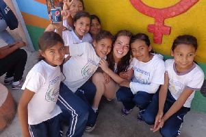 Carol-Anne pictured with some local children during her time volunteering with ICS in Honduras in 2013.