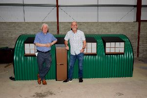 Willie Deery, on left, and Hugo McConnell pictured with the model of the Springtown Camp hut.  DER3019GS-032