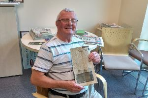 Tommy Mullan with the original article from the 'Derry Journal' back in 1973 and inset, the house where his parents and 10 siblings aged 13 months to 21, lived at 6 Brandywell Avenue.