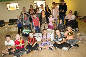 """The Mayor, Councillor Michaela Boyle takes part in a music workshop at Wednesday�""""s Fountain Street Community Centre�""""s Summer Programme supported by DCSDC�""""s Good Relations Team."""