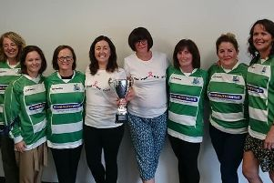 Katrina and Mary, centre, with some of the women taking part in the Mark Farren Memorial Cup.
