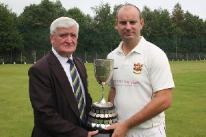 NWCU President, Connie McAllister, presents the Long's SuperValu Premier Division trophy to Brigade captain, Andy Britton.