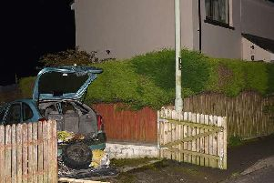 The vehicle where the Command Wire Initiated Improvised Explosive Device was located, parked in a driveway just meters away from a neighbouring property.