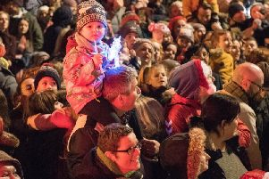 One young fan gets a pefect spot to watch the arrival of Santa during a previous Christmas Lights Switch on in Derry in Guildhall Square in 2017. Picture Martin McKeown. Inpresspics.com.