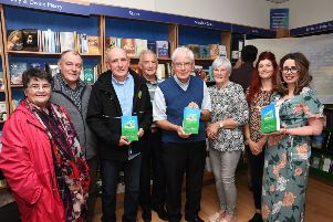 Fr Neal Carlin, fourth from right, pictured at the launch of his book 'Favourite Celitc Saints, A Simple Book of Prayers' in Veritas on Wednesday night with, from left, Noeleen Tynan, Peter Tynan, Aodan Carlin, Denis McGaughey, Celine McGaughey, Sinead Rainey and Jacklyn Roberts. DER3719-132KM