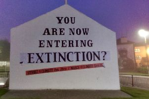 Free Derry Corner has been changed to carry an apocalyptic warning over climate change and threat facing the planet.