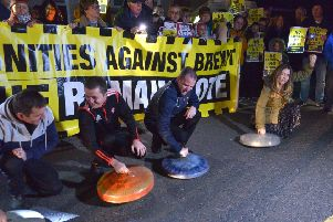 Border Communities Against Brexit supporters rattle bin lids at the protest held at Bridgend on Wednesday evening last.  DER4119GS - 030