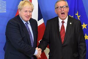 Prime Minister Boris Johnson and Jean-Claude Juncker, President of the European Commission, ahead of the opening sessions of the European Council summit at EU headquarters in Brussels on Thursday. (Photo: P.A. Wire/Stefan Rousseau)