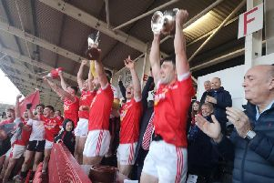 Magherafelt captain Danny Heavron lift the John McLaughlin Cup high above his head after the Rossas defeated Glen to win their first Derry senior crown since 1978
