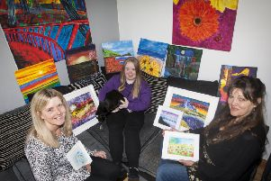 Tory McNeill pictured at her Waterside home with her mum (left) and tutor surrounded by some of the artwork which will be on display at two exhibitions next month in the city - one at The Waterside Theatre, starting Friday, 8th November and the other at the Garden of Reflection, Bishop Street starting Monday, 18th November. (Photos: JIm McCafferty Photography)