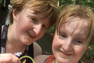 Claudy para-triathletes Chloe and Judith Mac Combe relax at home.