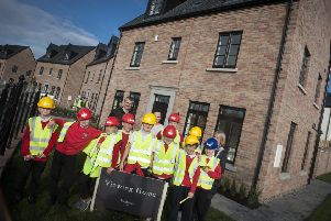 Braidwater representatives with children from Drumahoe P.S. at one of the local firm's other housing developments in the city.