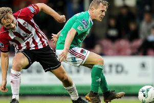 Former Cork City captain, Conor McCormack, pictured battling with ex-Derry City midfielder, Greg Sloggett last season, has opened talks about a return to Brandywell.