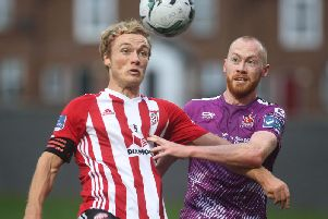 Former Derry City vice captain, Greg Sloggett, pictured in action against Dundalk midfielder, Chris Shields, recently signed a two year deal with the league champions.