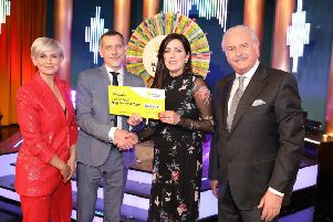 Louise Mills, from Culdaff, Co. Donegal has won 40,000 euro on last Saturday'sNational Lottery Winning Streak Game Show.  Pictured here at the presentation of the winners cheques were from left to right: Sinead Kennedy Winning Streak co-host; Ronan Leech, The National Lottery; Louise Mills, the winning player and Marty Whelan, Winning Streak Game Show co-host. The winning ticket was bought from An Post, Carndonagh, Co. Donegal. Pic. Justin Mac Innes/ Mac Innes Photography