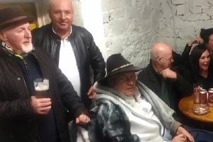 Terry Murphy (seated, wearing black hat) planned and attended his own wake. (Images/video courtesy of Justin McNulty)