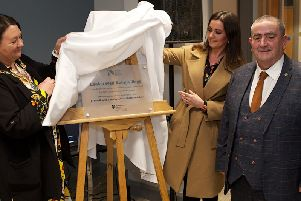 Mayor Michaela Boyle with Orla McStravick, Executive Office, unveiling a plaque at the official opening of the Leafair Wellbeing Village. Included is Peter McDonald, Leafair Community Association.