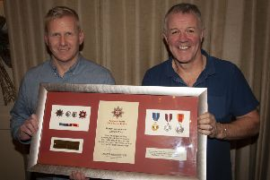 """Group Commander Jonathan Tate makes a special presentation to Watch Commander Jim Ross on the occasion of his retirement from the Northern Ireland Fire and Rescue Service, at the Bishop�""""s Gate Hotel on Thursday night last. (Photos: Jim McCafferty Photography)"""