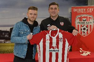 Derry City's new signing, midfielder Conor Clifford, pictured with manager Declan Devine.