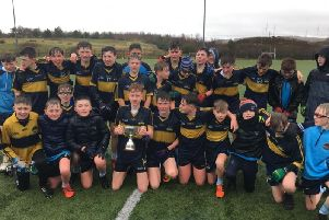 Lumen Christi College players celebrate their Nannery Cup victory on Wednesday in Garvahey.