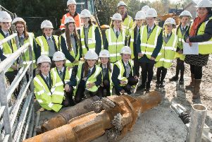 Year nine pupils from Thornhill College and their teacher Sheena Scott pictured in 2018 with  Firmus Energy Construction Manager, Jonathan Strain,and Declan Carlin, Project Manager, Kier, when they visited Firmus Energy's  Foyle Crossing where a gas pipeline emerges from under the River Foyle . The pupils inspected the drill bit which was being used during the project which was worn beyond use. Picture Martin McKeown.