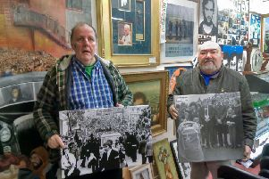 Tony O'Hara and  Danny Morrison with photographic exhibitions from the funerals of local men who died on Hunger Striker, with the Papal cross in the background
