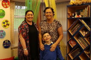 Caolan O'Neill with his mum Amanda and St Paul's Primary School teacher MIss Fox