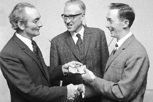 1969... Playwright Brian Friel (on left) hands over the keys to Shantallow Community Centre to Derek McCauley. Pictured centre is GH Bryson, chairman of the board of the Housing Trust.