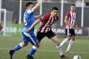 Derry City's Ciaran Coll skips away from Finn Harps' Tony McNamee during last season's derby at the Brandywell.