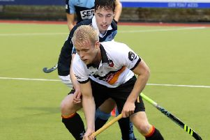 Lisnagarvey's  Sean Murray and Banbridge's Peter Brown in action on Sunday. Pic: Presseye.