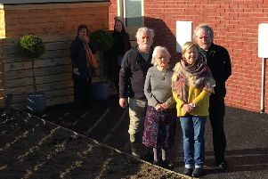 Patricia Lee (front right) is pictured with her mother Elizabeth Doherty (83) with her two sons Paul and Jeffrey Doherty. The missing plants are pictured behind the group.